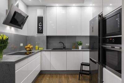 Beautifully designed kitchen in white and grey with steel elements