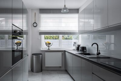 Narrow kitchen with window and modern, gray furniture